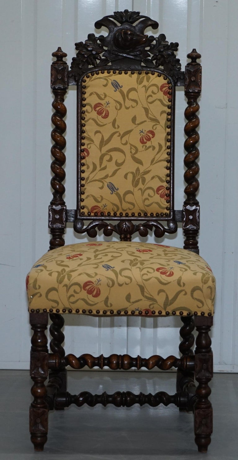 Hand-Carved Set of 10, circa 1800 Oak Jacobean Style Dining Chairs with Dog Head Cresting For Sale
