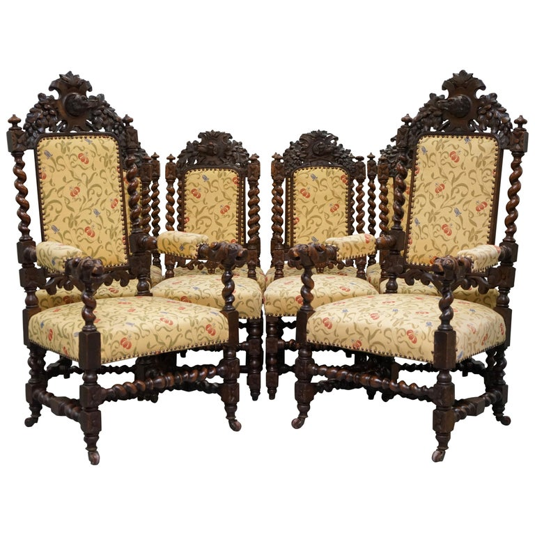 Set of 10, circa 1800 Oak Jacobean Style Dining Chairs with Dog Head Cresting For Sale