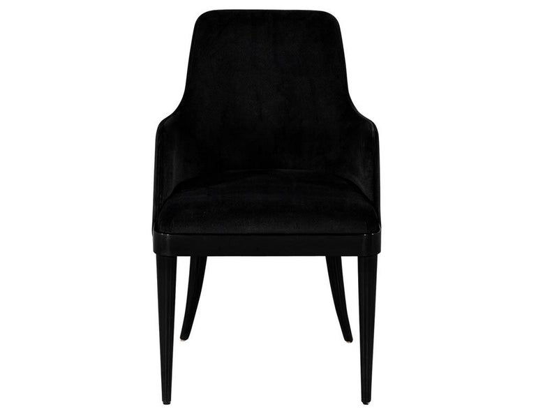 Set of 10 custom black modern dining chairs by Carrocel. This transitional style dining chair features a curved backrest and a seat inset from the wooden base. Sitting atop tapered curved rear legs. Finished in a high gloss black lacquer finish with