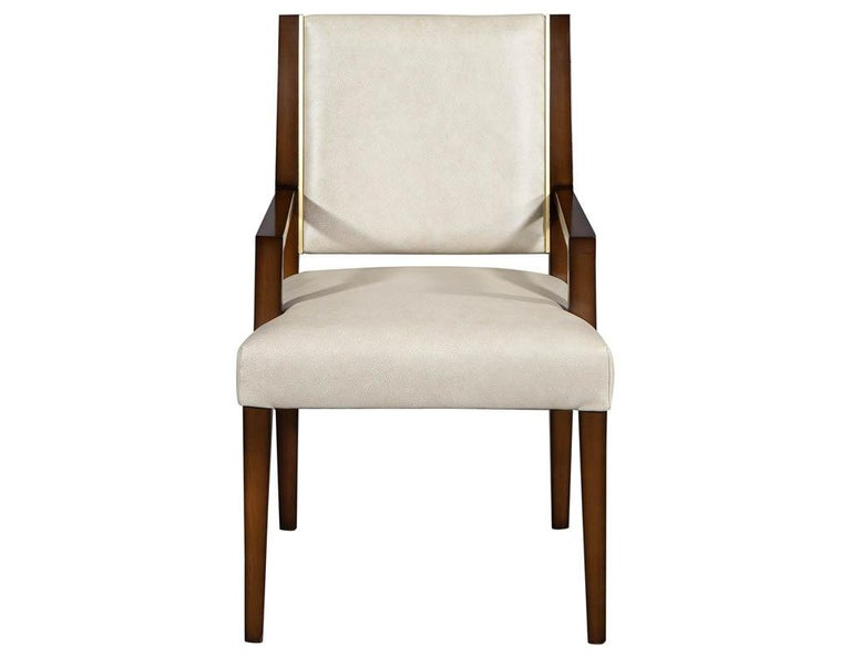 Set of 10 custom modern leather dining chairs with brass. Carrocel custom Nevio dining chair. Featuring clean modern lines, Mid-Century Modern inspired design with inlay brass detail. Handcrafted here in Toronto, Canada by our master craftsmen.
