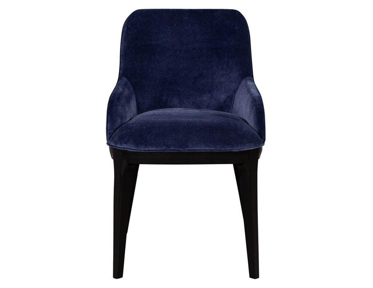 Set of 10 custom Navyvelvet modern dining chairs. Featuring modern contoured curved backs with sculpted legs in an ebonized finish. Set includes 8 side chairs and 2 armchairs.  Price includes complimentary scheduled curb side delivery to the
