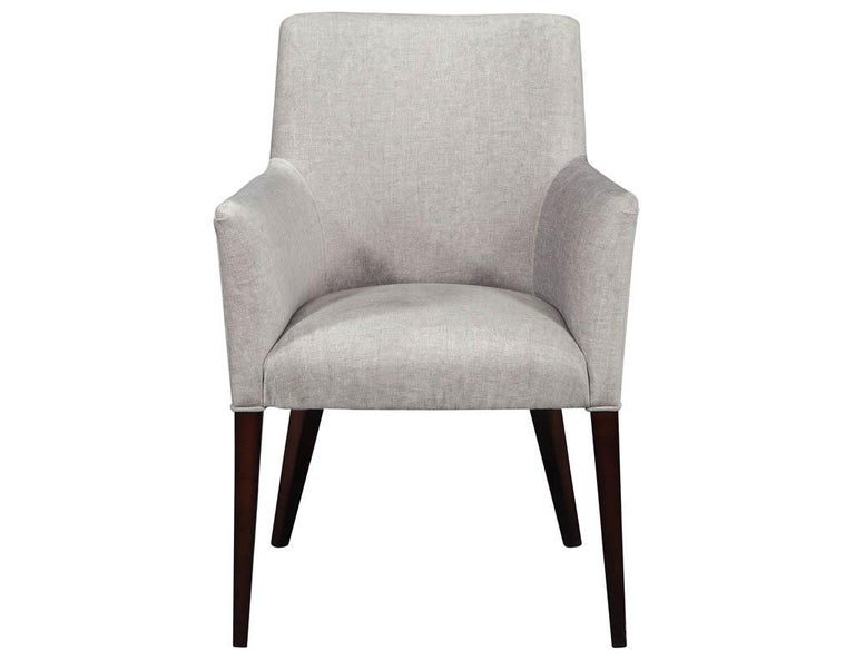 Set of 10 custom relari modern dining chairs by Carrocel. These sleek chairs have an Italian modernism with a fine cut elegant detailed design. Upholstered by our craftsmen in a designer fabric and finished in a hand rubbed espresso walnut.  Price