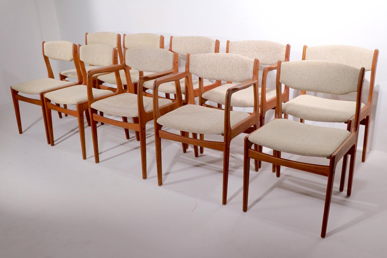 Nice large set of ten Danish Mid-Century Modern dining chairs attributed to Erik Buch for Odense Maskinsnedkeri. Unusual to find a set of ten, perfect for a very large dining, or conference table setting. Solid teak frames, upholstered seats and