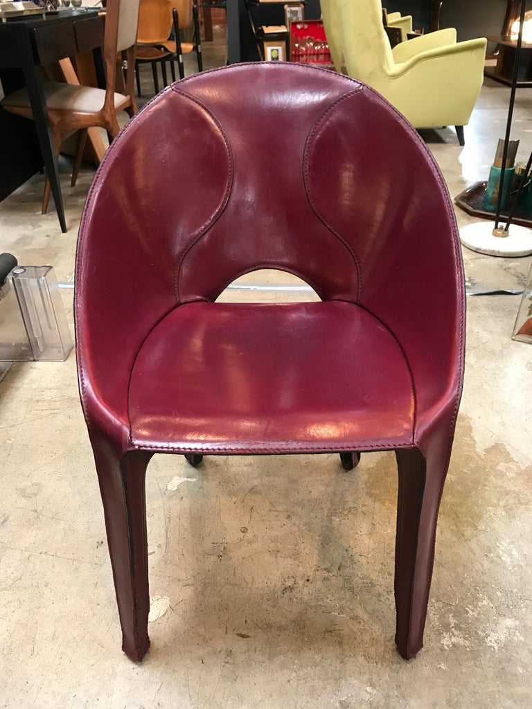Stunning set of 10 burgundy leather chairs for Cassina studio, 1970s, Italy. The chair is very comfortable and unique. Signed CASSINA on the bottom   Each chair can be sold individually, $ 1,600/each.