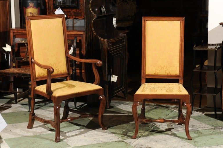 The set of 10 English Queen Anne Style walnut dining chairs with tall upholstered backs, cross stretchers and cabriole legs. 2 of the chairs are early 18th century and 8 are late mid - late 20th century.