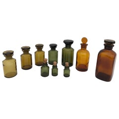 Set of 10 French Perfume-Pharmacy Bottles in Green and Amber, with Lids/Stopper
