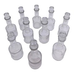 Set of 10 Hand Blown Glass Bottles with Stoppers from a Parisian Restaurant