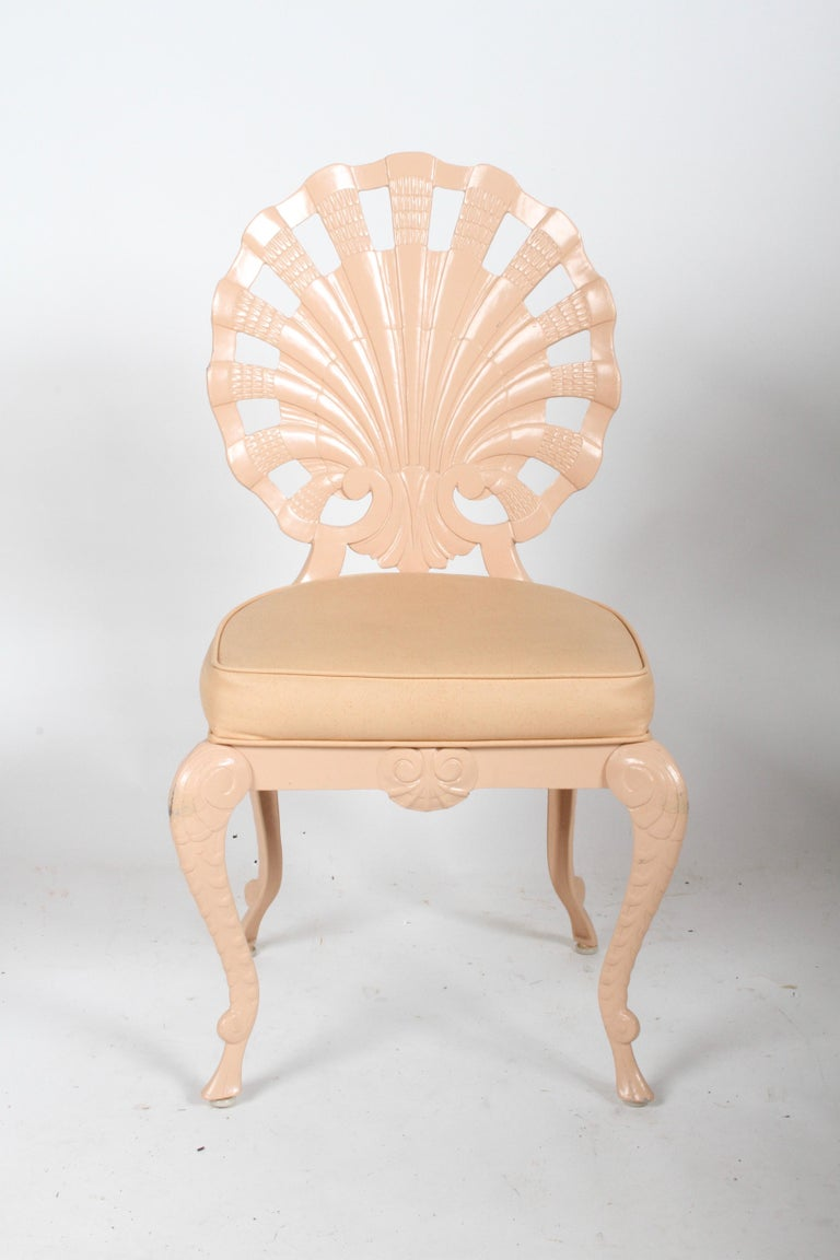 1970s Hollywood Regency set of 10 Grotto style cast aluminum side chairs with shell form backs, with original pink paint and seats on cabriole legs. Paint shows wear, should be repainted in perfection is sought or if other color is desired. Please