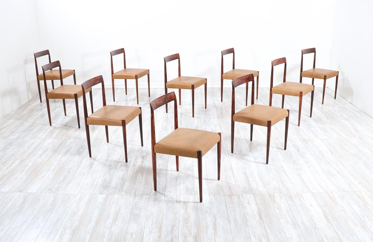 Set of 10 Mid-Century Modernrosewood and leather dining chairs by Lübke.