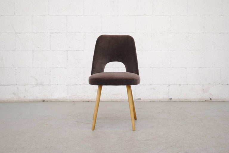 Newly re-upholstered Thonet dining chairs by Oswald Haerdtl in cafe velvet. Most retain the original labels underneath. Set price.