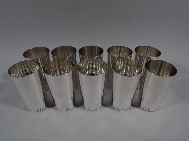 Set of 10 fabulous sterling silver highballs. Made by Tiffany & Co. in New York. Each: Cylindrical with curved bottom. Clean and spare with incised bands at base. Easy-grip size for knocking 'em back. Fully marked including pattern no. 22394. Eight