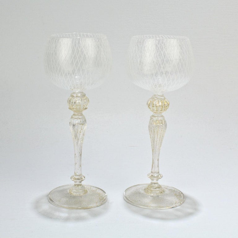 An elegant set of 10 Venetian glass wine glasses.