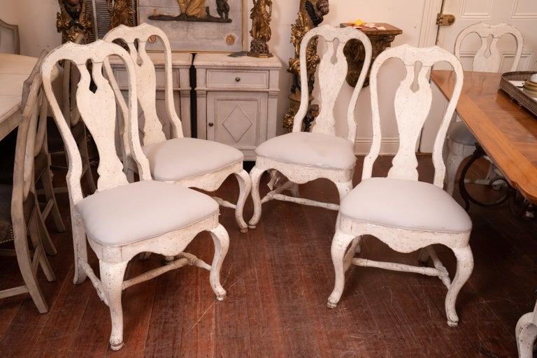 A set of 12 19th century Swedish design dining chairs. The chairs are very sturdy and comfortable.