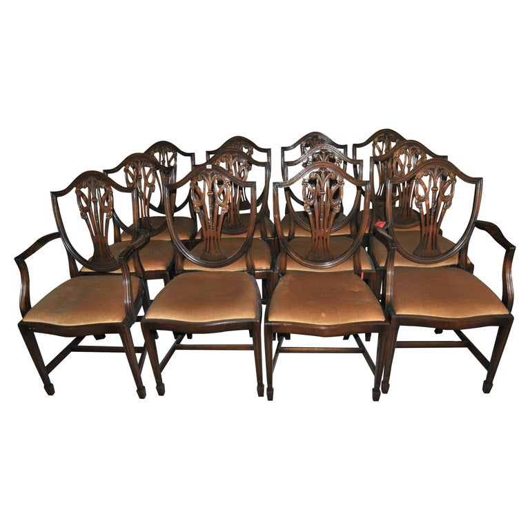 Set of 12 20th Century English Mahogany Hepplewhite Style Shield Back Chairs For Sale