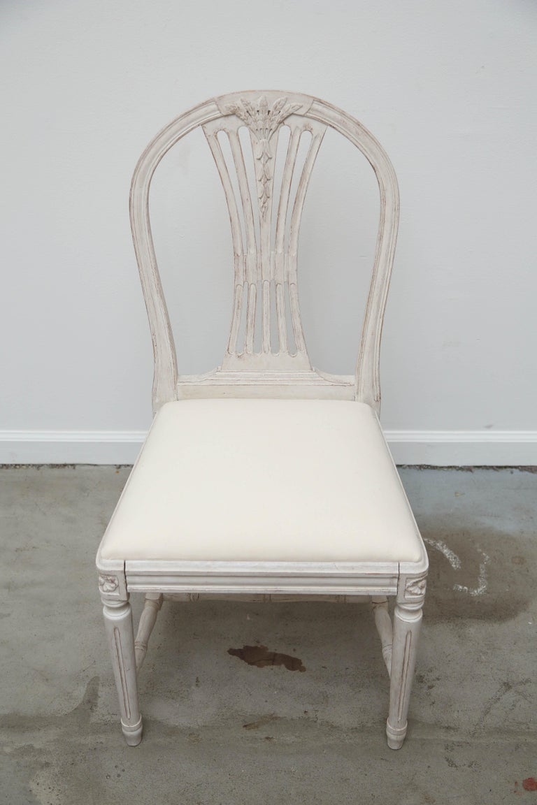 Swedish Set of 12 Antique Painted Gustavian Style Dining Chairs Early 20th Century For Sale