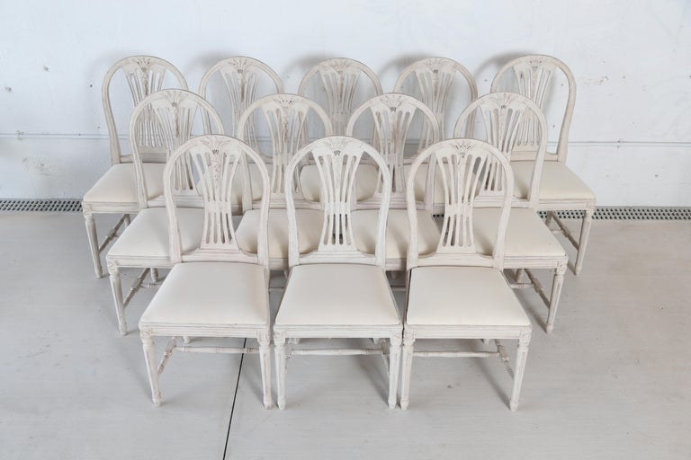 Swedish Set of 12 Antique Painted Gustavian Style Dining Chairs For Sale