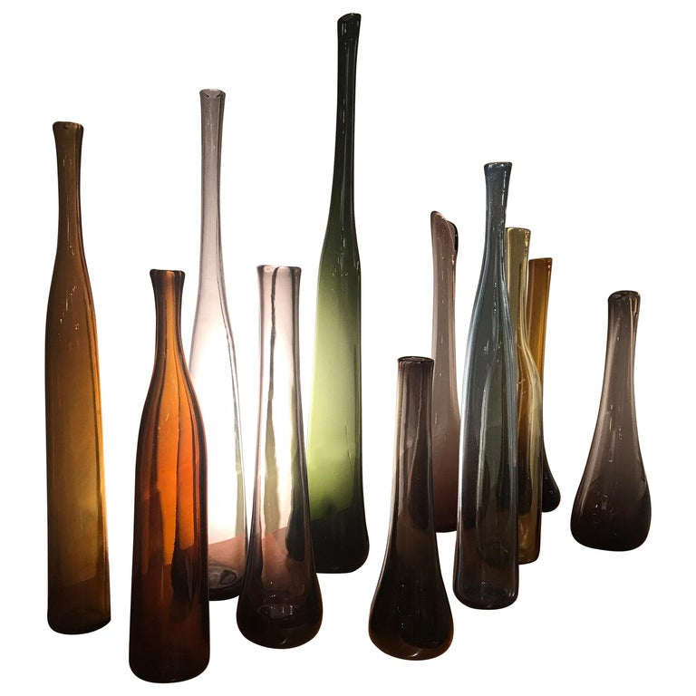 Set of 12 Blown Bottles by Claude Morin For Sale