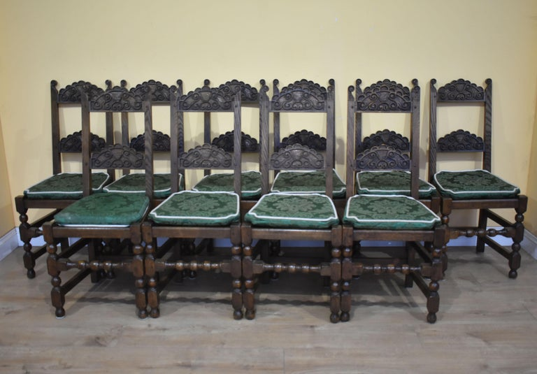 For sale is a good quality set of 12 carved oak dining chairs. Each chair has two carved back rails and Stand on turned legs, united by straight and turned stretchers. Each chair is made from solid oak and remain structurally sound and in very good