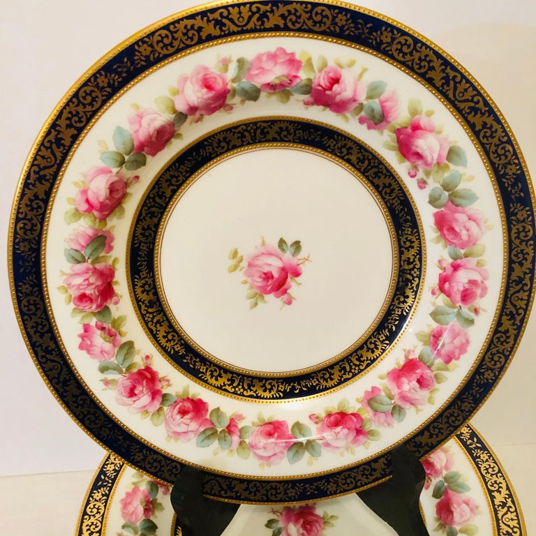 20th Century Set of 12 Cauldon Wide Rim Soups with Pink Rose Paintings and Two Cobalt Borders For Sale