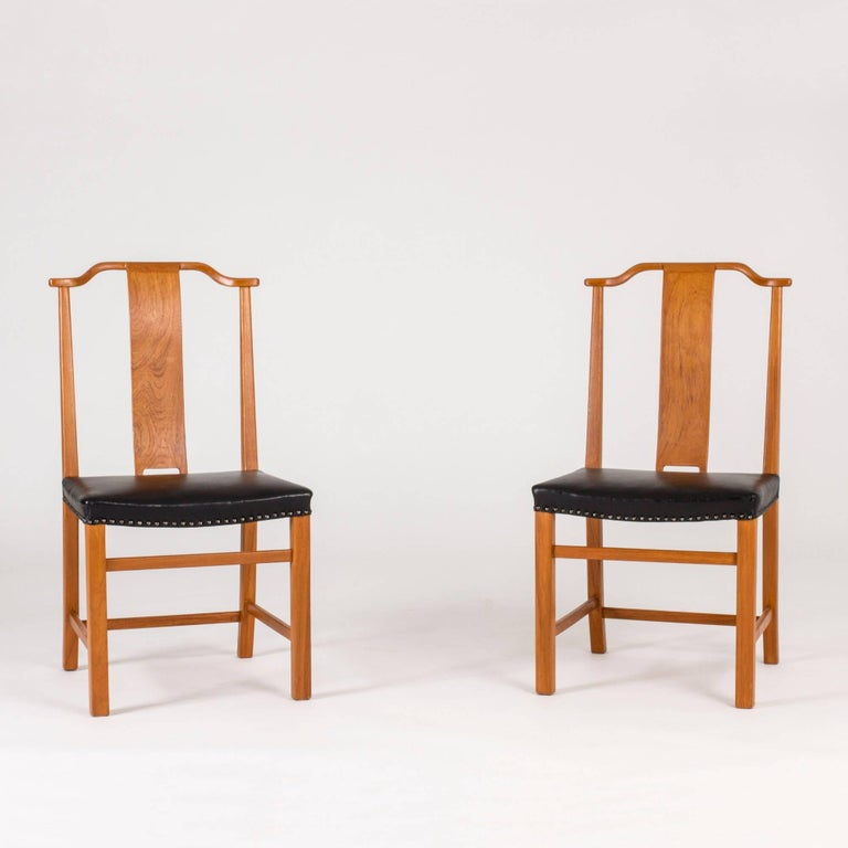 Scandinavian Modern Set of 12 Dining Chairs by Axel Larsson For Sale