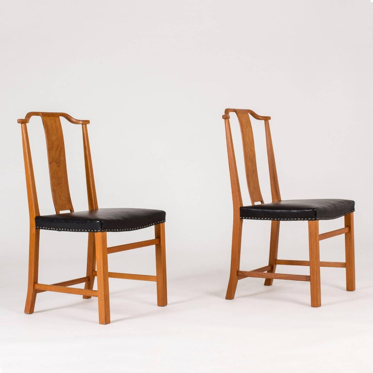 Swedish Set of 12 Dining Chairs by Axel Larsson For Sale