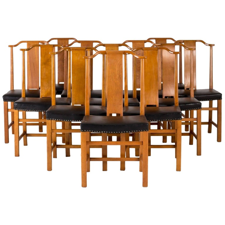 Set of 12 Dining Chairs by Axel Larsson For Sale