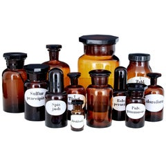Set of 12 Early 20th Century Apothecary Glass Jars