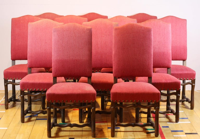 Set of 12 French oak Os de Mouton dining chairs with chapeau de gendarme backs, constructed from solid oak with original upholstery in pale pink fabric.