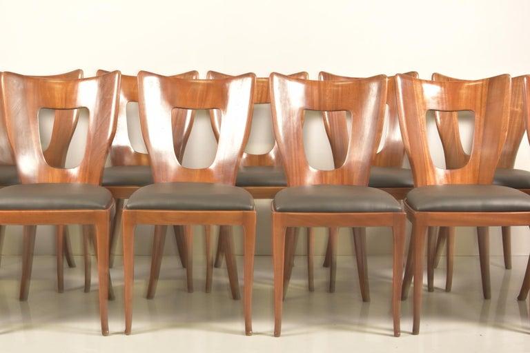 Set of 12 Italian modern mahogany dining chairs, Osvaldo Borsani.