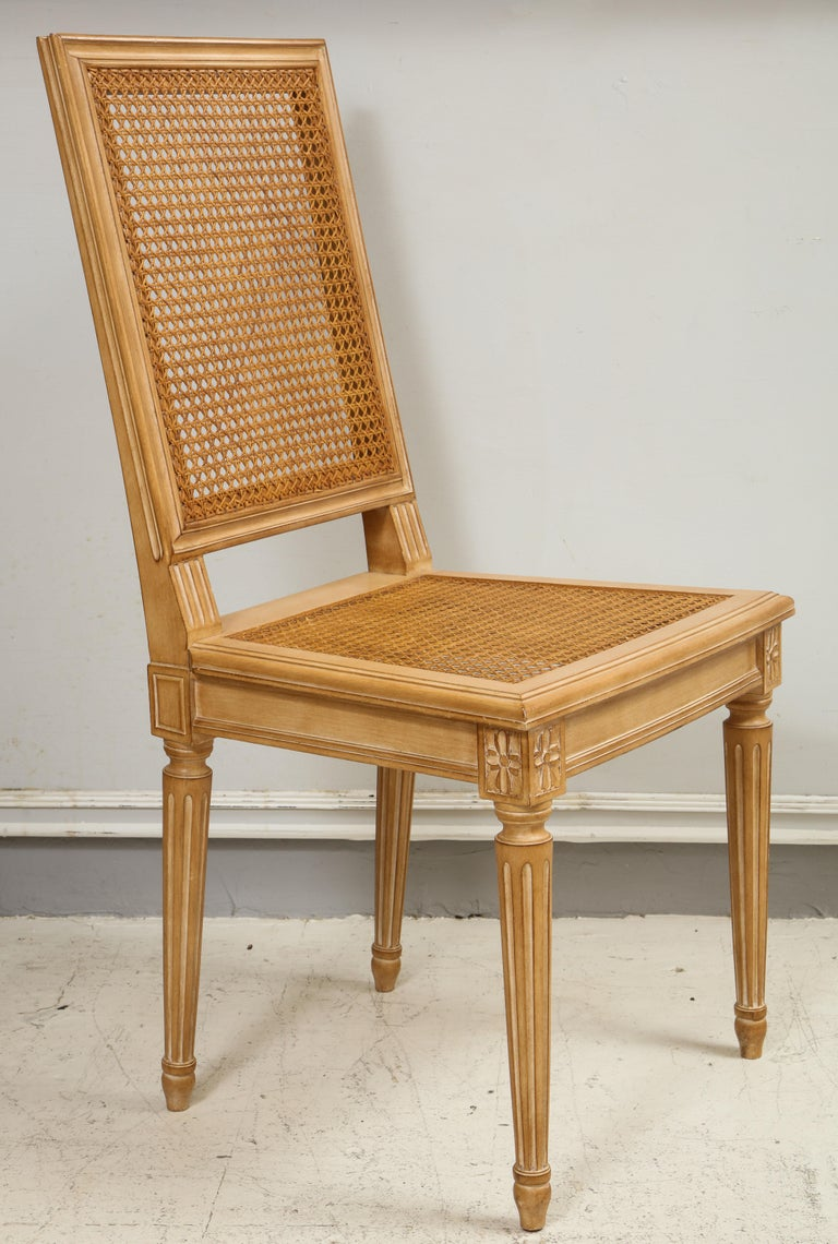 Set of 10 Louis XVI style hand-caned dining chairs.