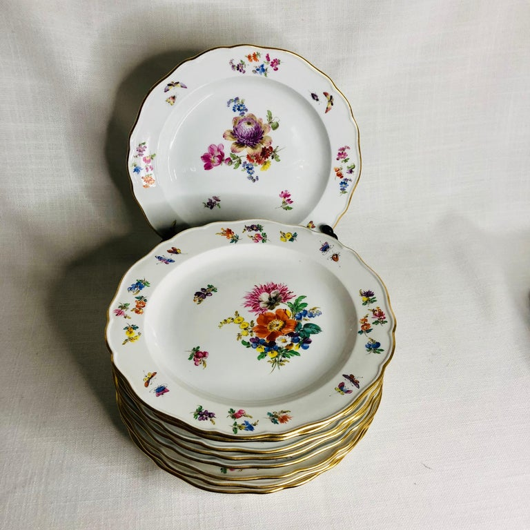 This is a fabulous set of twelve Meissen luncheon or dessert plates. Each of these Meissen plates are beautifully painted with a different large central flower bouquet. The artwork on these plates is exceptional. Inside the gold border, you. can see