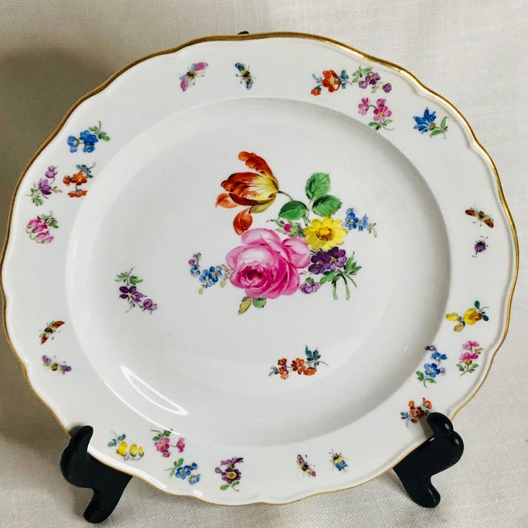 Early 20th Century Set of 12 Meissen Luncheon Plates Each Painted with a Different Flower Bouquet For Sale