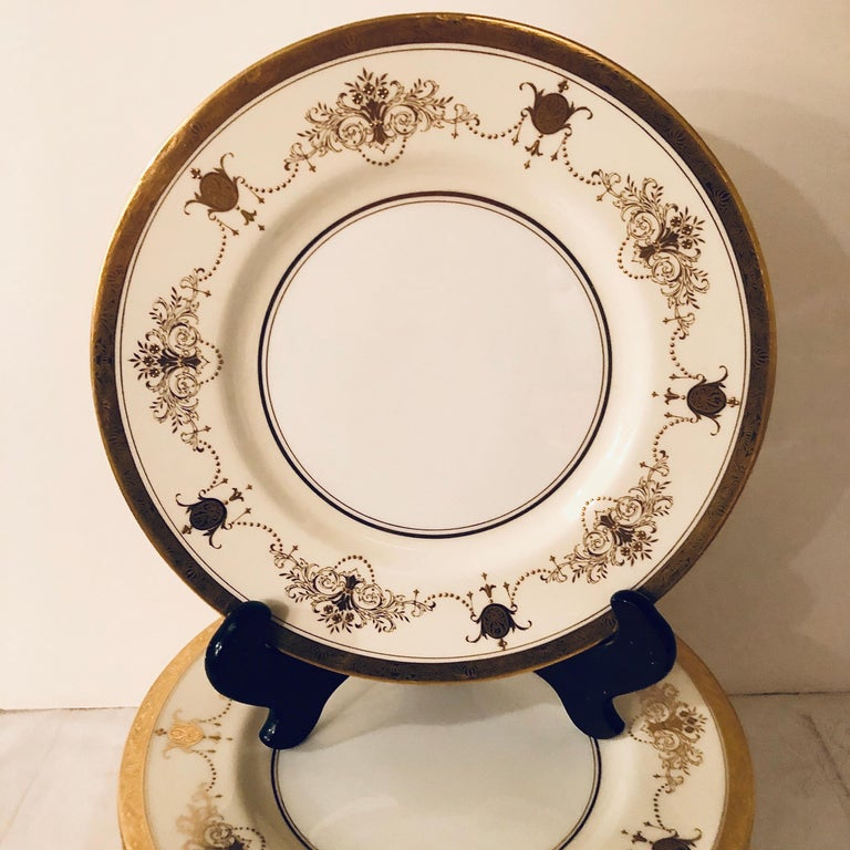 Rococo Set of 12 Minton Dinner Plates Decorated with Ribbons of Raised Gilded Jeweling For Sale
