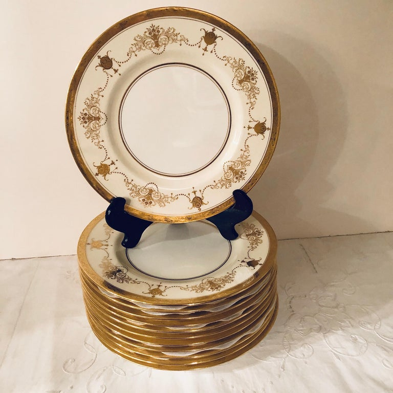 Gilt Set of 12 Minton Dinner Plates Decorated with Ribbons of Raised Gilded Jeweling For Sale