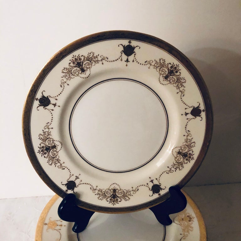 Early 20th Century Set of 12 Minton Dinner Plates Decorated with Ribbons of Raised Gilded Jeweling For Sale