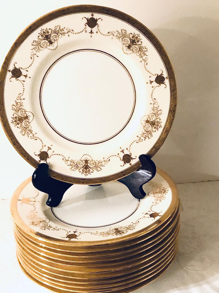 Porcelain Set of 12 Minton Dinner Plates Decorated with Ribbons of Raised Gilded Jeweling For Sale