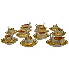 Set of 12 Period Empire Bisque Porcelain and Gilt Swan Cups, Marked Sevres