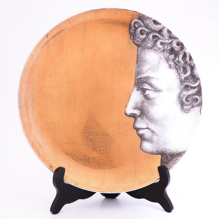 12 plates of model Adamo (Adam) designed by Piero Fornasetti in the 1950s. Piero Fornasetti created one set of Adam and one set of Eva containing 12 plates each. These plates are 26 cm in diameter and in very good condition, there might appear a few