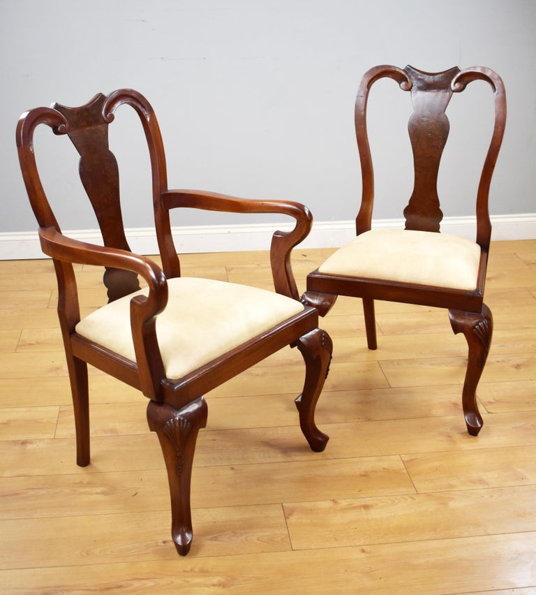 For sale is a good quality set of 12 Queen Anne style burr walnut dining chairs, each with vase shaped backs above drop in seats standing on cabriole legs. Each chair is structurally sound and in good condition having been recently re-upholstered