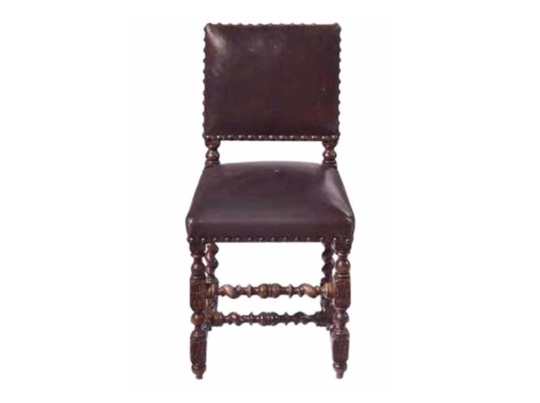 Renaissance Revival Set of 12 Renaissance Style Carved Oak and Leather Upholstered Dining Chairs For Sale
