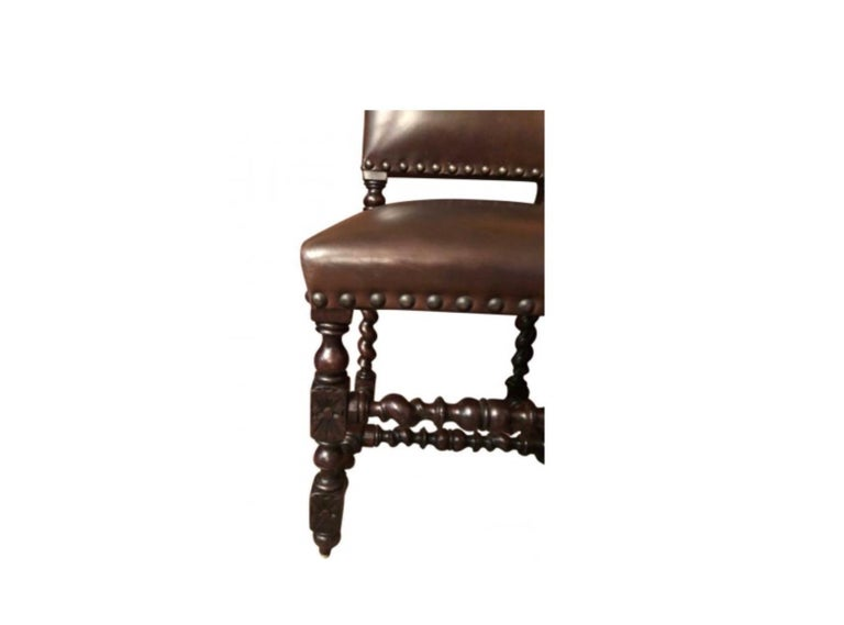 Set of 12 Renaissance Style Carved Oak and Leather Upholstered Dining Chairs In Good Condition For Sale In LOS ANGELES, CA