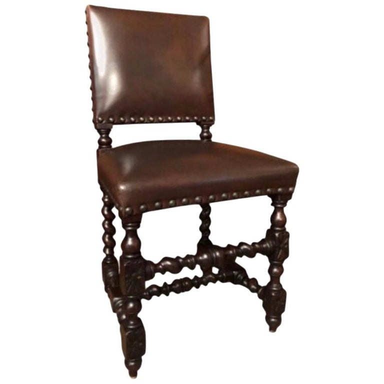 Set of 12 Renaissance Style Carved Oak and Leather Upholstered Dining Chairs For Sale