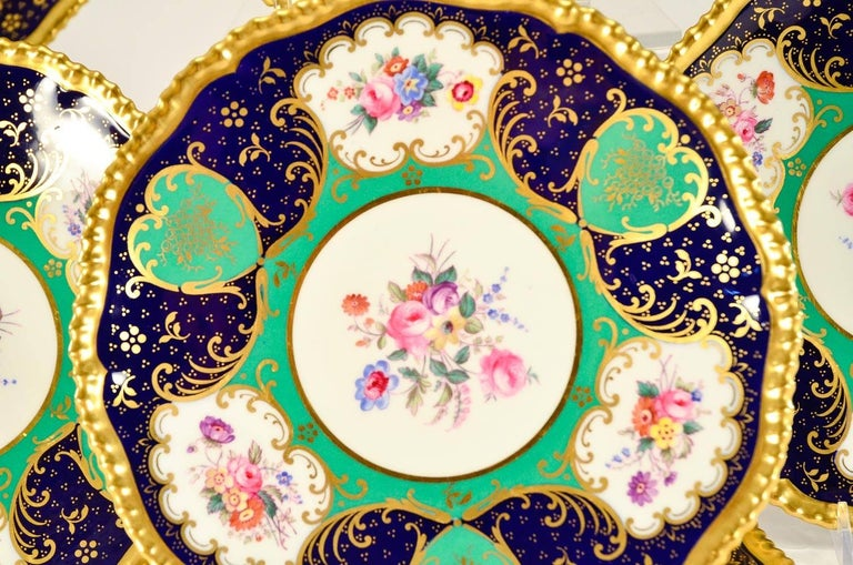 This set of 12 Spode Copelands, Sevres style dessert plates combine all the best features of both design and practicality. The combination of Classic Sevres green with cobalt blue, hand-painted floral reserves and gilded highlights, creates a