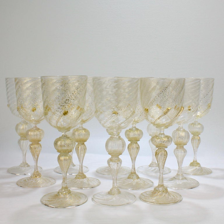 A vintage set of 12 large-sized Venetian glass water goblets or wine glasses.  Attributed to Salviati.  Finely blown with applied swirled prunts to the base of the cups and gold inclusions throughout.  Rare large-size goblets of the finest