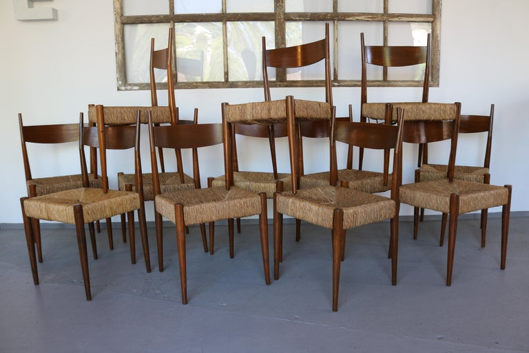 This extraordinary set of 12 chairs is very reminiscent of Egon Eiermann's design. The chairs were also typical for Eiermann in a church. There is still a book holder on one chair. Very discreet chair connectors are processed on the front legs. The