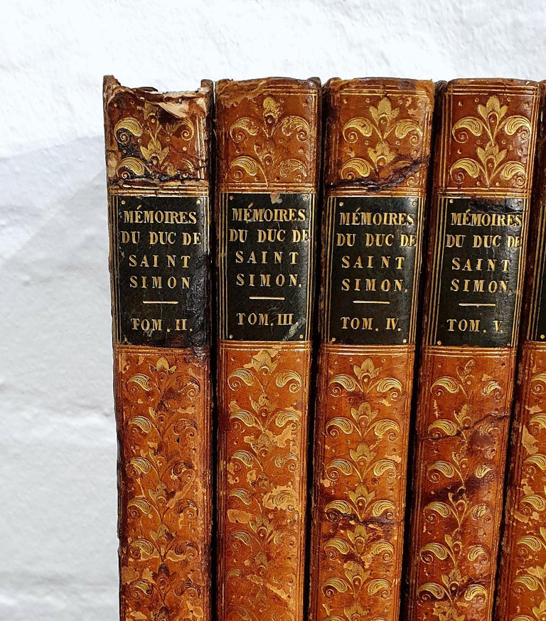 These beautifully leather bound French books are a set of 13, all of which date between 1829-1830. Each book is bound in a rich tone of tan, detailed with gold leaf embossing. The books do have some small amount of damage and water markings, but do