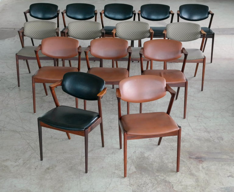 Set of fourteen model #42 dining chairs also known as the