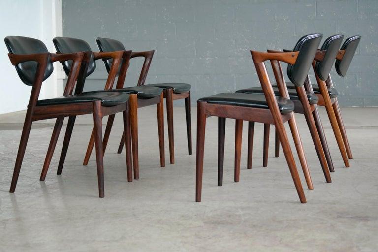 Mid-Century Modern Set of 14 Kai Kristiansen Model 42 Rosewood Dining Chairs for Schou Andersen