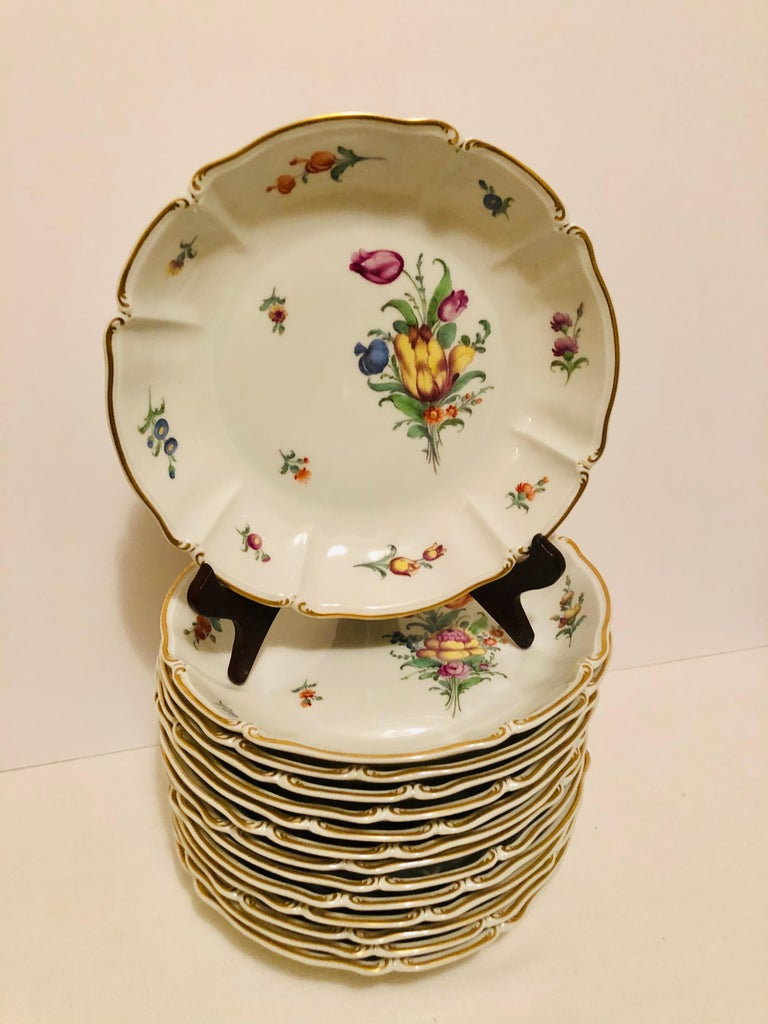 I want to offer you this stunning set of fourteen Nymphenburg very deep soup bowls. Each of these soup bowls are painted with a different colorful and exquisite flower bouquet. These bowls are much deeper than most wide rim soup bowls. They would be