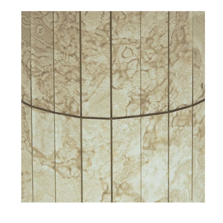 These time-weathered and delicately colored canvased mosaic glass panels by Antique Mirror are made up of wispy and swirling shades of white, gray, and gold. It will add a romantic and romantic accent to walls in both modern and traditional homes.